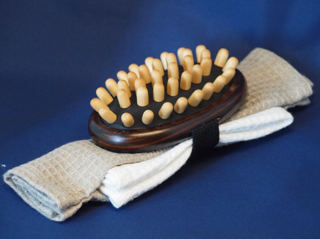 Gastendoek met massageborstel